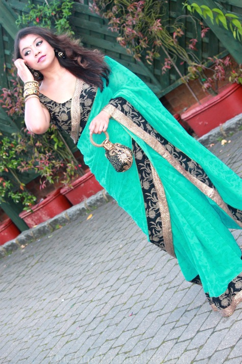 SareeSutra: Georgette Saree with Sequins Border