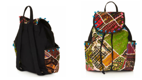 Top Shop's multi-colored patchwork embroidered backpack with mirror and pom pom details and flap closure