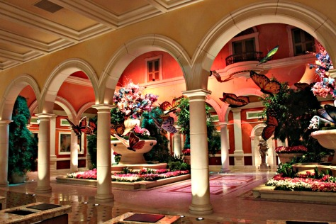 My outfit blends well with the theme of the Hotel Bellagio! They call it Fiori de Como- The hotel lobby of Bellagio Las Vegas is, in a word, grand, both in scale and in design. Above the 18-foot ceiling is a coffer filled with the most extraordinary glass sculpture, a chandelier called Fiori di Como by glass sculptor Dale Chihuly, whose work has been exhibited in every major museum in the world. This stunning piece is comprised of 2,000 hand-blown glass blossoms. Chihuly glass art sculptures also adorn the Bellagio Baccarat Lounge with the Clusters Persians centerpiece as well as his Blue Spears which outline areas of the Conservatory and Botanical Gardens.