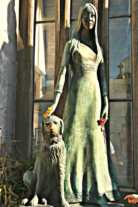 A statue of a woman and her dog pictured at the cemetery of Recoleta in Buenos Aires