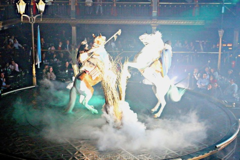 When the show began, 10 people dressed like neaderthals darted out onto the stage, followed by two LIVE horses