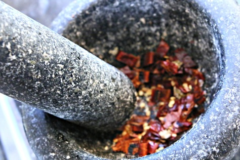 Don't have chilli flakes at home? I have crushed dry red chillies using my mortar and pestle