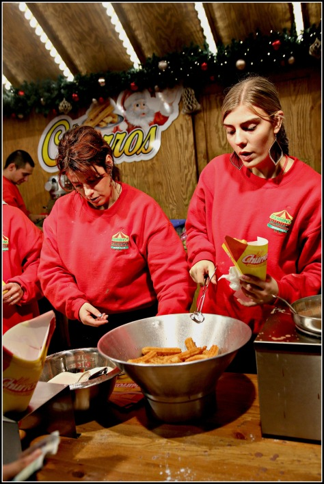 Charming ladies serving Churros- one more reason for men to go out there and order one;)