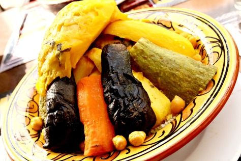 Moroccan Couscous with Seven Vegetables- this famous Moroccan dish features a mound of steamed couscous topped by stewed chicken or meat and vegetables