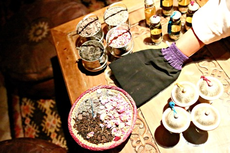 Scrubber, body oils and rose petals to be used in the treatment