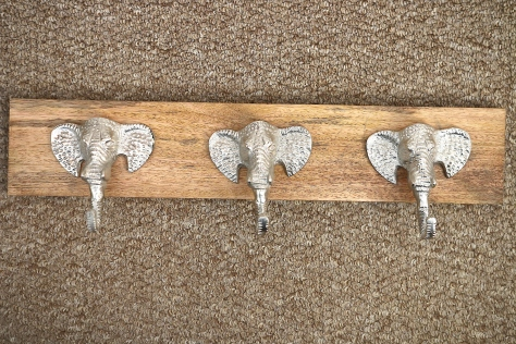Finding an antique silver elephant faced wall hook rack in TK Maxx that will be new home for my three (at least) hats