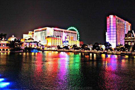 Neon lights shine the Vegas Strip at night