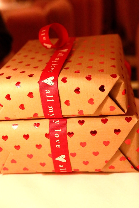 Hand-wrapping presents for my beautographer with handmade papers with heart print from Card Galore