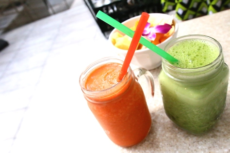 Our morning detox obsession continues with a glass of fresh green smoothies made of kale, spinach, celery and avocado and a glass of carrot-orange juice