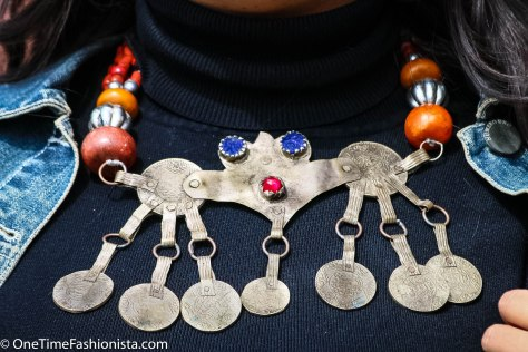 A stunning, original, rare and very wearable Berber necklace with an unusual and lovely Tiznit area enameled pendant, orange tube beads and a historical mix of silver coins