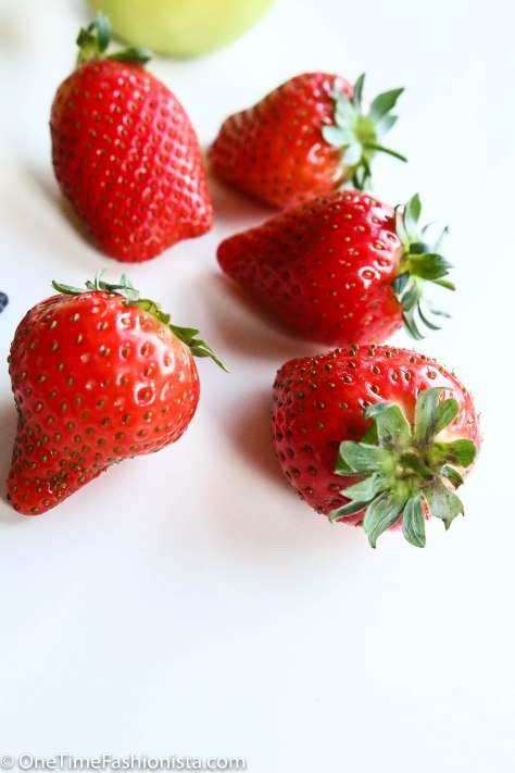 Wash them, remove the crown and make thin vertical slices. Use only the slices from the centre of the strawberry