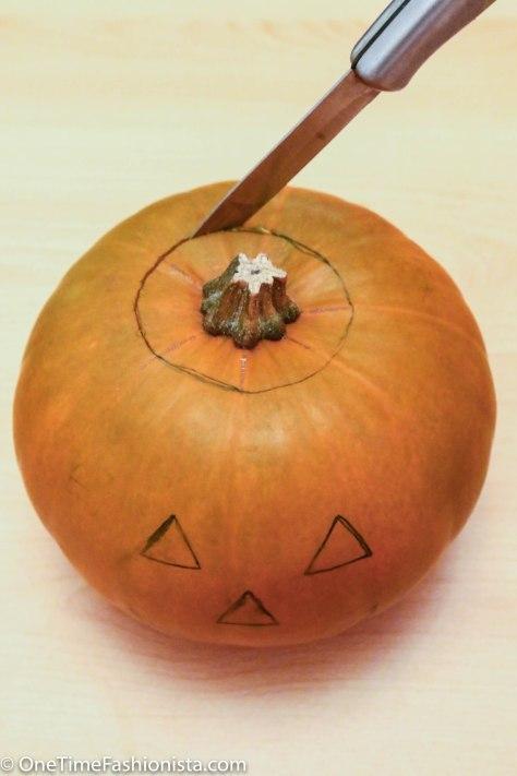 Cut a hole in the pumpkin