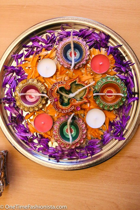 Rangoli on a Thali: Made with fresh flowers, handmade diyas and scented tealights, presented on a Moroccan silver plate