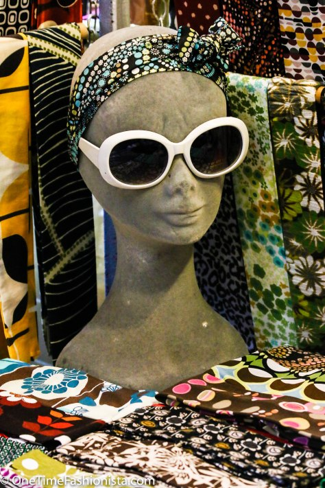 Stall selling skinny scarves in quirky prints: Christmas Gift ideas under 10 pound