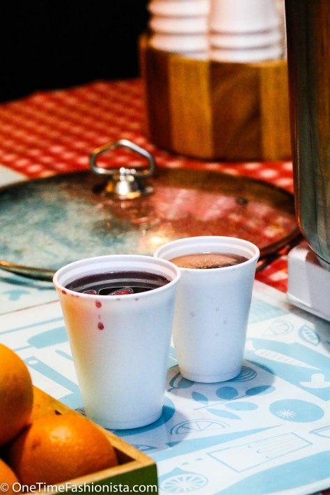 A large sized glass of mulled wine for the gentleman and a small sized glass of winter tea for the lady