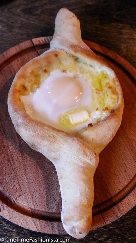 "Adjara/Azari khachapuri: the famous ""khachapuri boat"" with an egg in the middle."