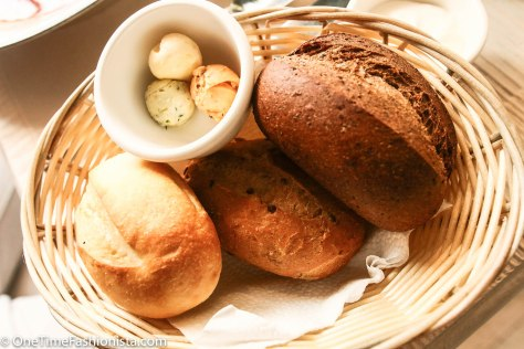 Here, the bread baskets are not complimentary