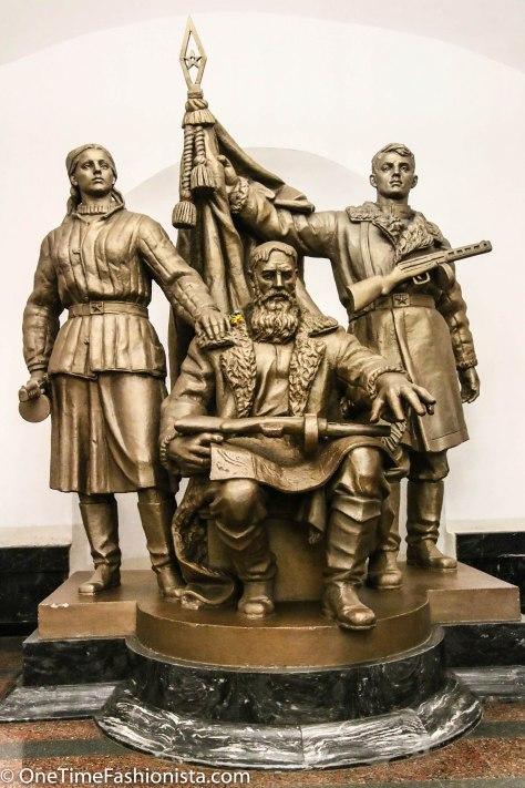 Statue of revolutionaries in Ploshchad Revolutsii Metro Station