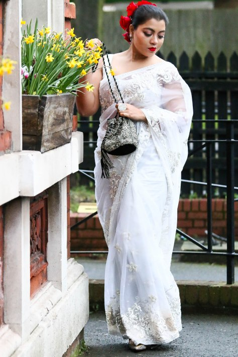 SareeSutra: Embellished White Net Saree and Rosy Sun Rays Hair-do